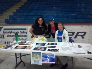 Annie, Caitlin, and Katrina at their booth for Super Science Day
