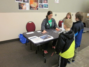 "Caitlin engages kids in a round of ""Cosmic Survey"" at ArtTrek"